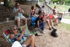 Debbie, Austin, Karen, Paul, Greg, Wayne, Anne, Helen, and Jeanne listen to Slim's band at the Cabbagetown Reunion Festival.