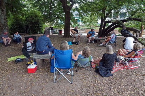 Friends gather under the big tree in Cabbagetown Park to hear Greg and friends perform.