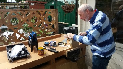 Woodwork bench being used for the first time.