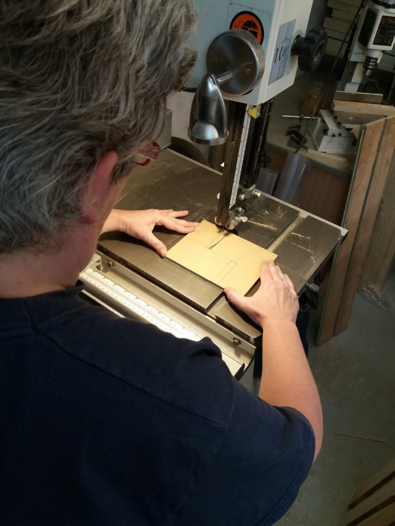 Sue cuts shapes from MDF using the bandsaw