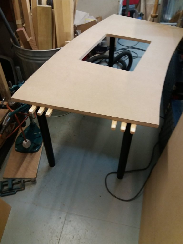 the central section of the desk with hatch hole
