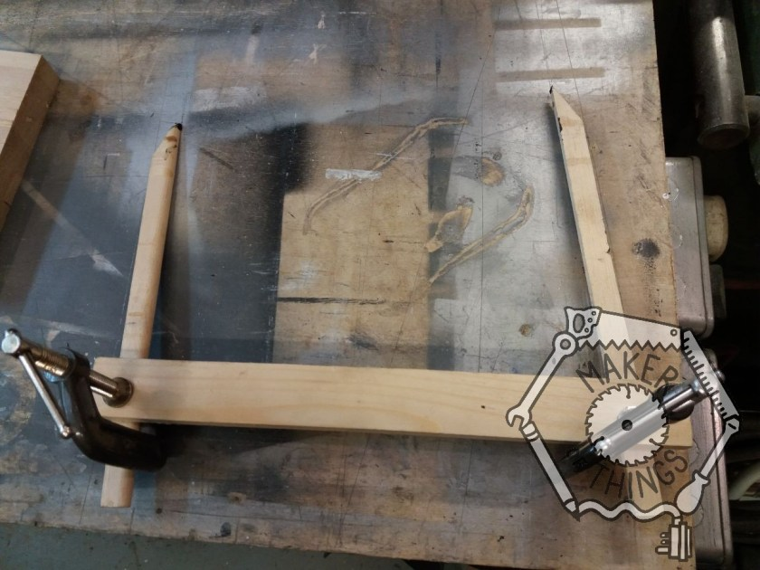 Two pointed sticks with small G cramps attached to a longer stick to make an adjustable caliper.