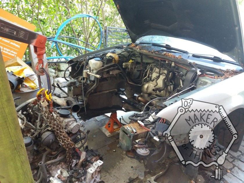 Another photo of the engine bay with the engine and transmission removed off to the left.