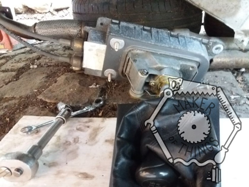 The gear lever and mechanism lying underneath the car.