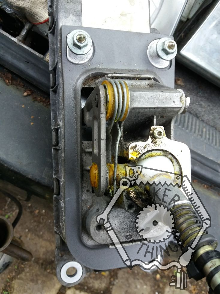 A view of the gear lever mechanism showing two of the fixing bolts at the front and the shape of the gasket that sealed it to the hole in the floor.