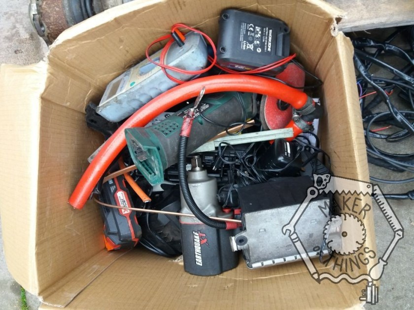A view in the box of random stuff. there is a drill, an angle grinder, an air impact wrench, and a lot more stuff.
