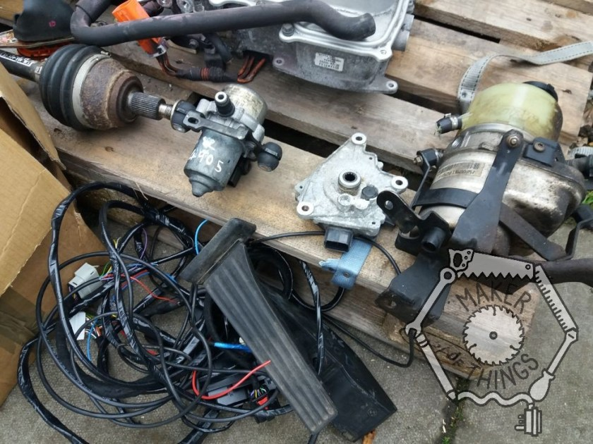 A close up of some of the smaller stuff on the pallet showing the electric power steering pump, vacuum pump, throttle pedal, and a 'thing'!