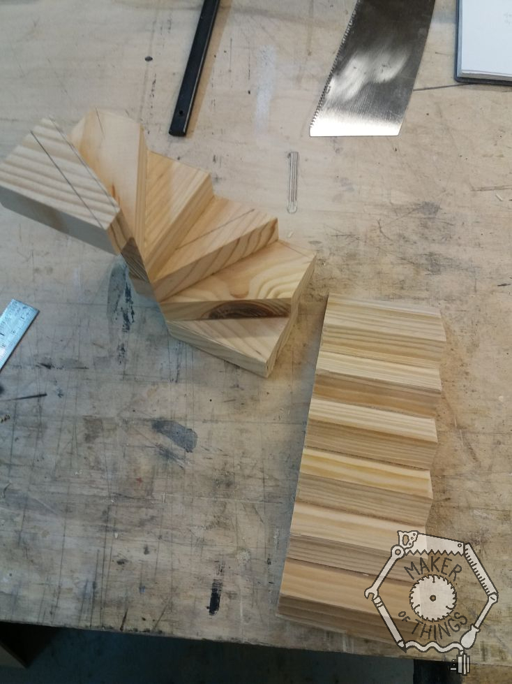 The work bench with dolls house size wooden stairs in progress. A straight flight of six steps and a 180 degree winding section of six steps turning to the left.
