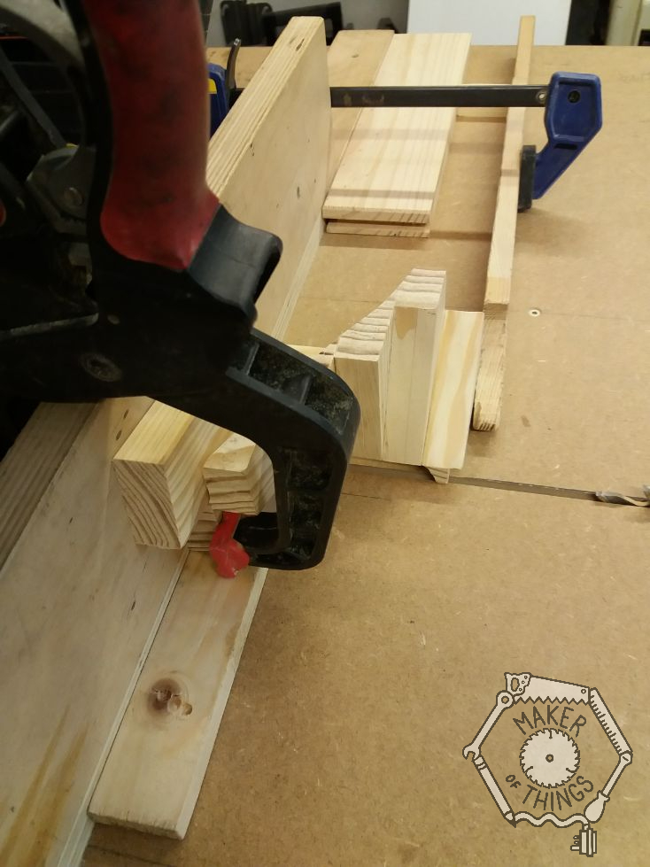 A side view of the stair winder clamped over the table saw.