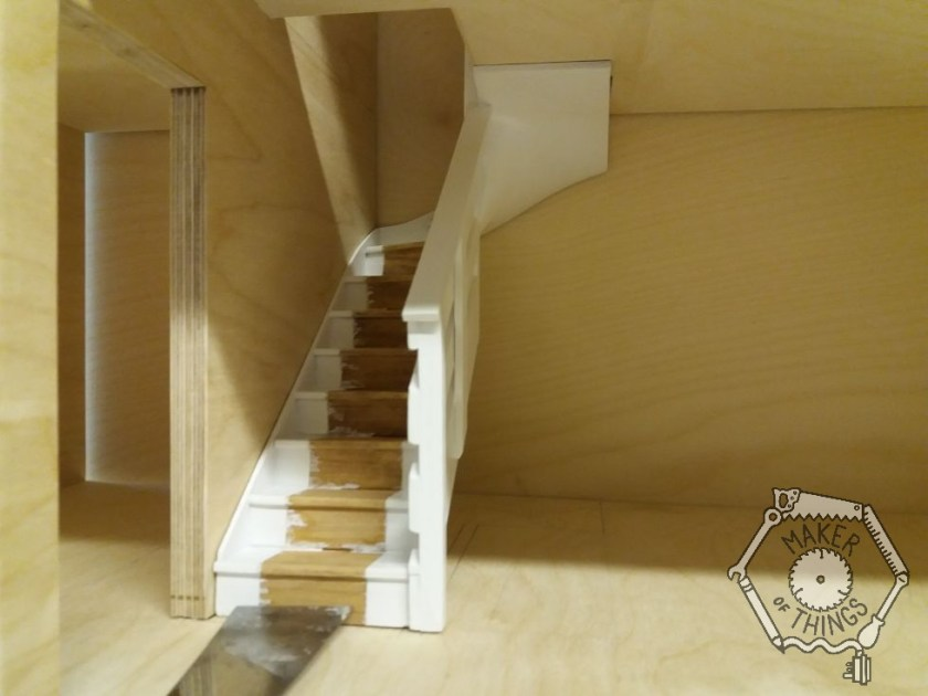 The white painted stairs loose installed in the dolls house.
