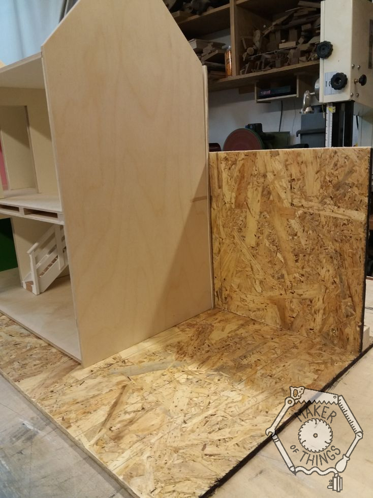 A right side view of the house gable end set on the OSB background.