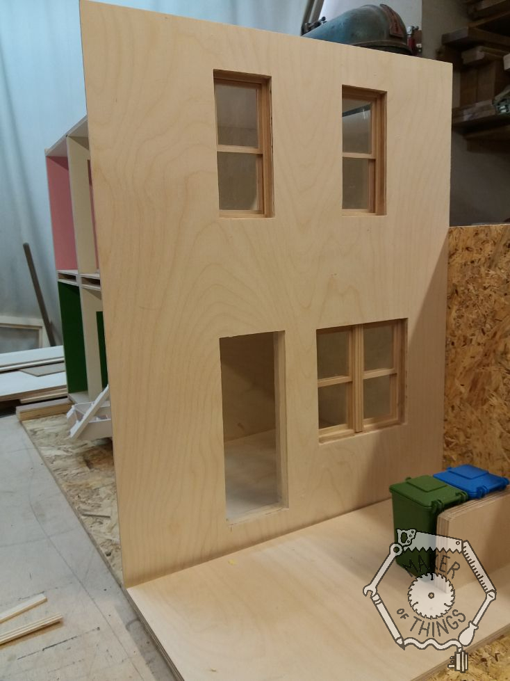 The front of the house with the window apertures squared cornered, and the sash windows test fitted.