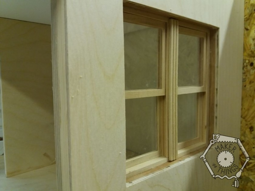 A close up of the living room window showing the recess it is fitted into.