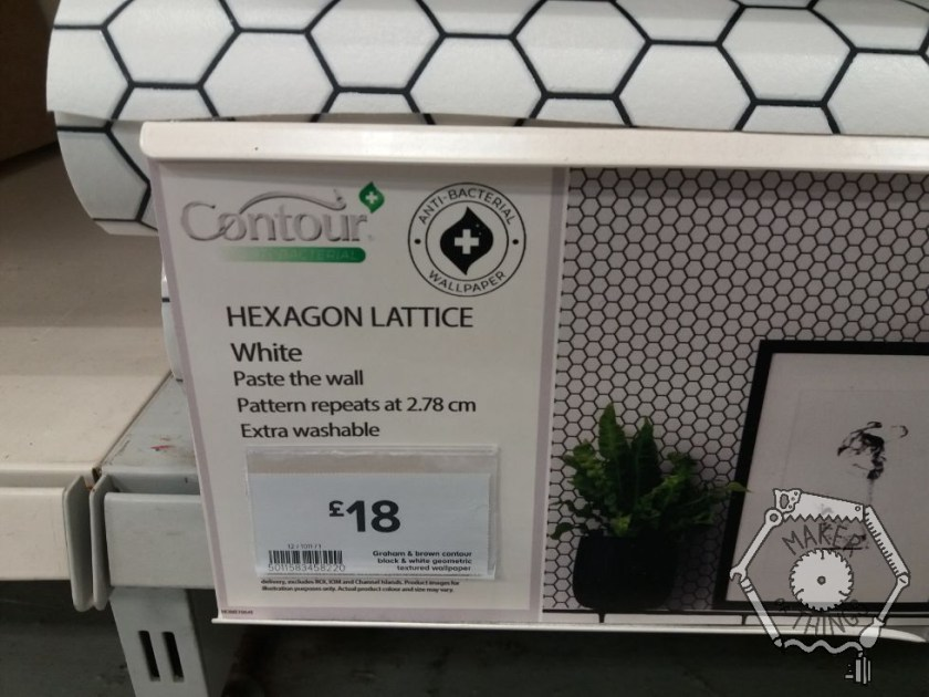 Wallpaper display in a shop, the description says: 'Centour. Hexagon Lattice, White. Paste the wall. Pattern repeats 2.78cm. Extra washable. £18.'