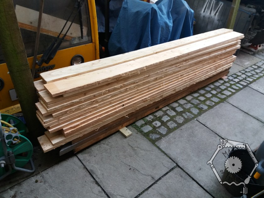 A pile of larch boards, 25 x 150 x 2600mm
