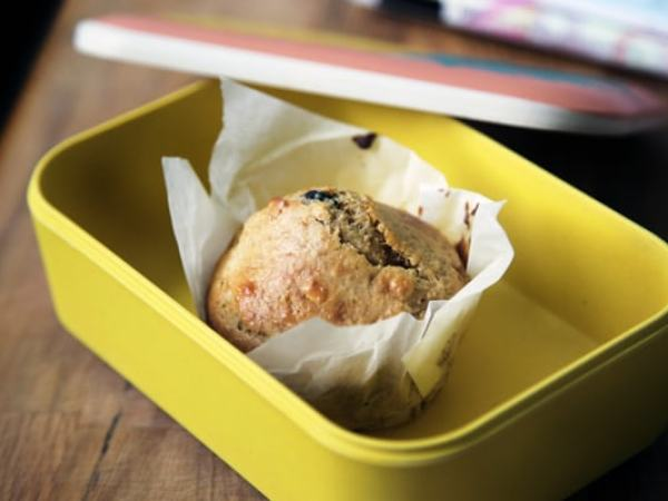 yellow lunch box with a single muffin inside