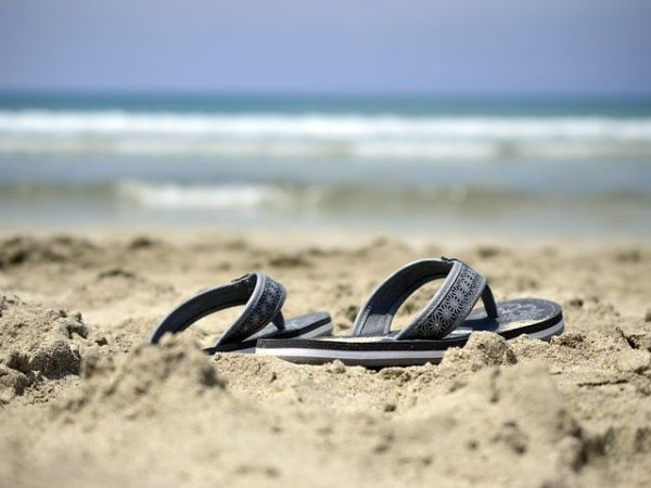 sandals on a sandy beach