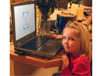 little girl in front of laptop