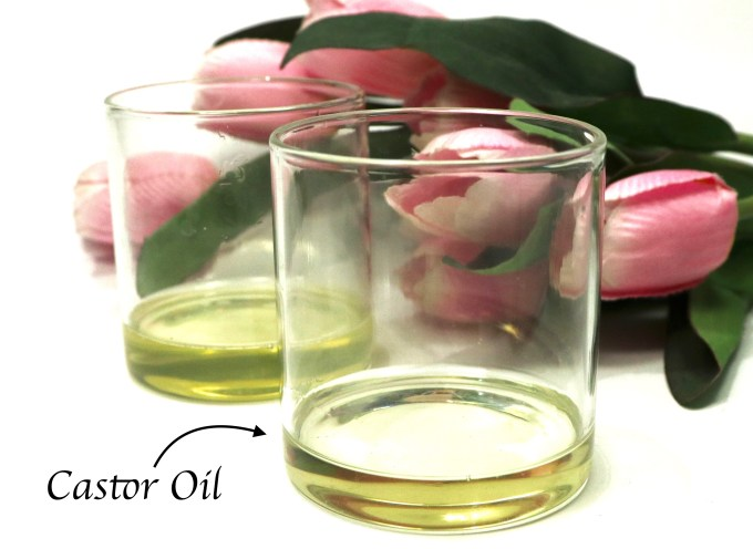 DIY Castor and Coconut Oil Deep Conditioning Mask For Hair Growth Castor Oil in a glass container