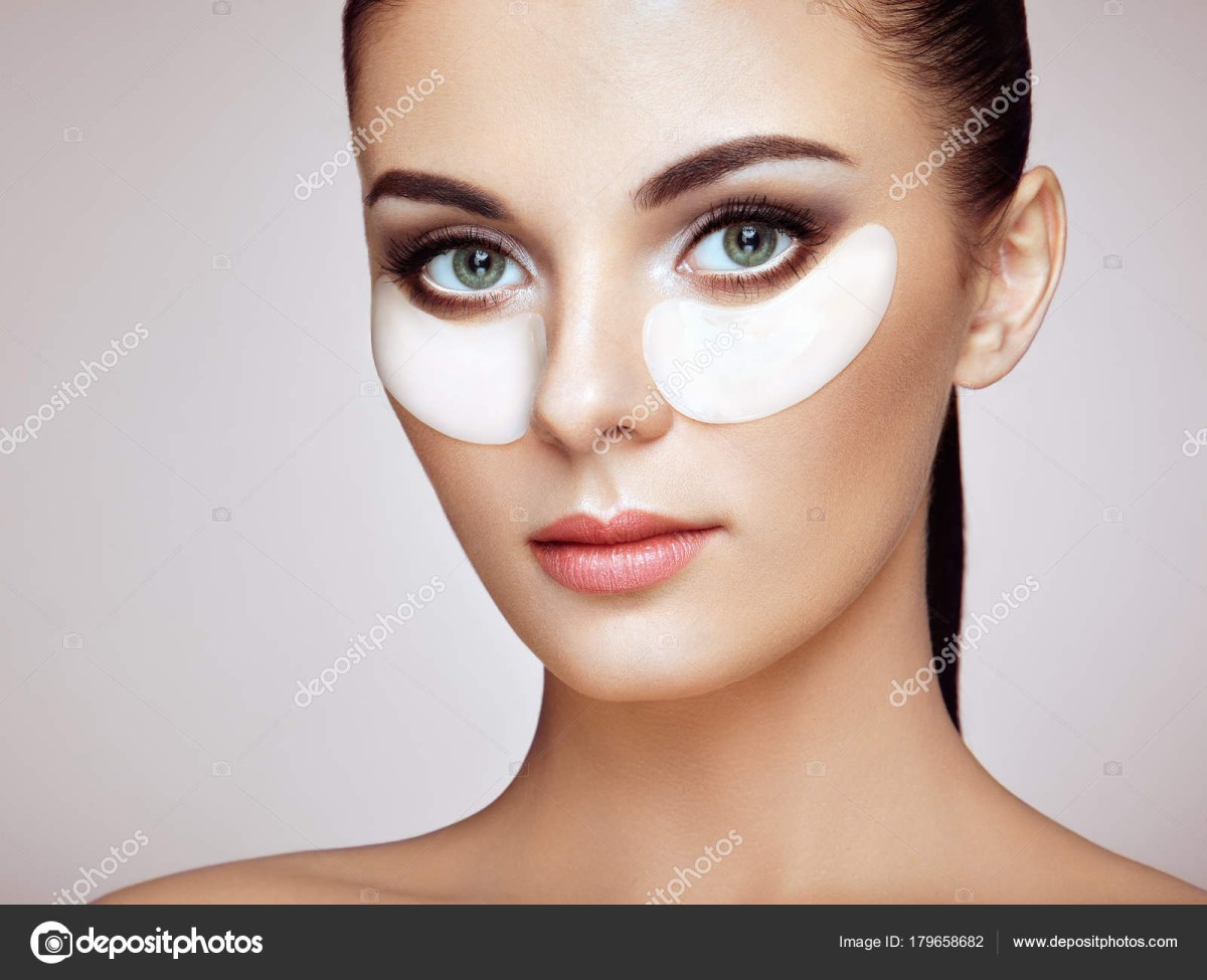 White Makeup Under Eyes Portrait Of Beauty Woman With Eye Patches Stock Photo