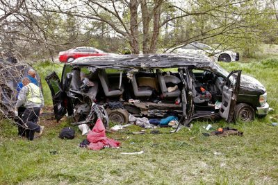 """Investigators work at the scene where three people died early Monday, April 6, 2015, when a van carrying members of two heavy metal bands crashed near the town of Commerce, Ga., about 65 miles northeast of Atlanta, according to authorities. Members of the Atlanta-based band, """"Khaotika, """" and the Huntsville, Ala.-based band, """"Wormreich, """" were in the van. Georgia State Patrol Cpl. Scott Smith said the driver of the 15-passenger van """"apparently fell asleep and allowed the vehicle to leave the roadway, at which time the vehicle struck a tree on the passenger side."""" (AP Photo/Atlanta Journal-Constitution, Bob Andres) MARIETTA DAILY OUT; GWINNETT DAILY POST OUT; LOCAL TELEVISION OUT; WXIA-TV OUT; WGCL-TV OUT"""