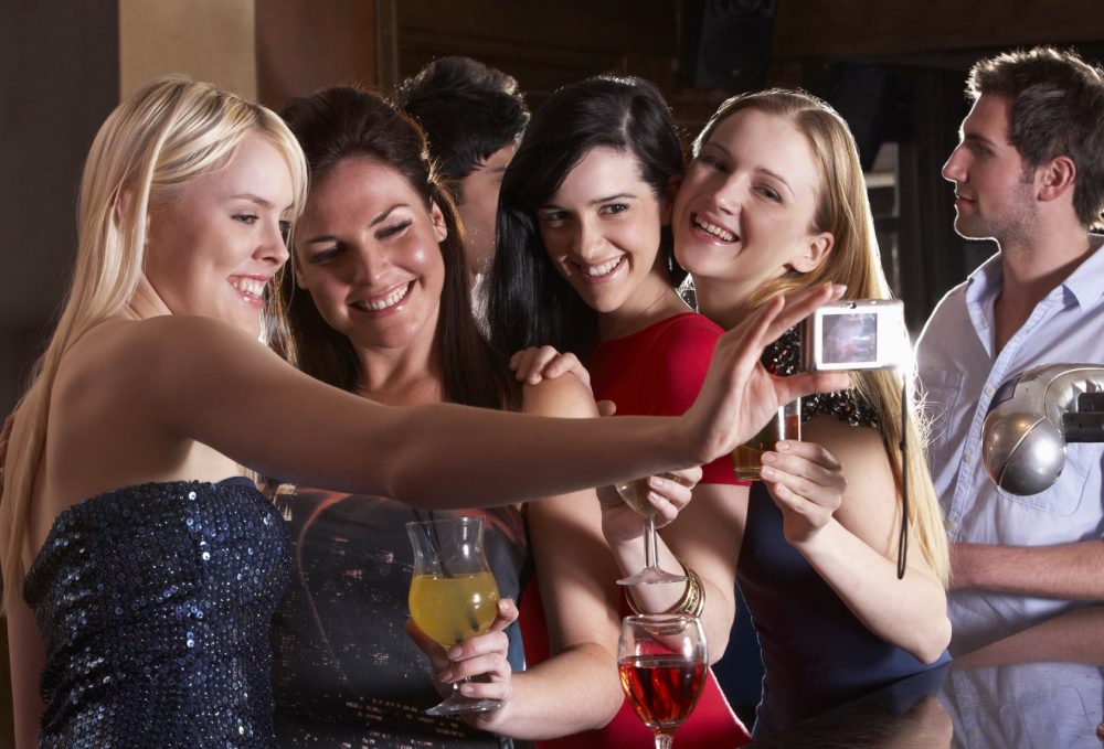 Young women drinking at bar