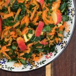 Kale Slaw with Apples,Carrots and Raisins in a pretty bowl