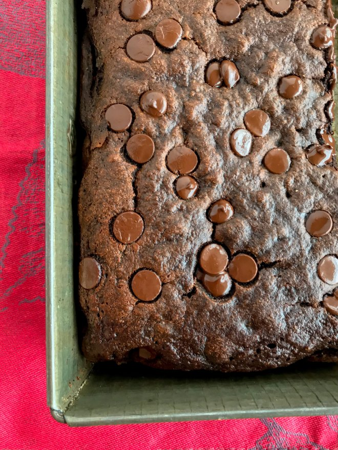 Baking pan with Chocolate Banana Snack Cake with melted chocolate chips on top.