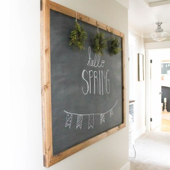 This large DIY chalkboard is so simple to make and, unlike most others out there, actually hangs on the wall like a piece of art. | www.makingitinthemountains.com