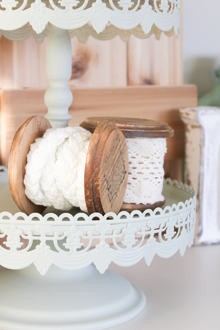 This vintage wooden spool is such a lovely way to store and display those pretty ribbons you've collected over the years. | www.makingitinthemountains.com
