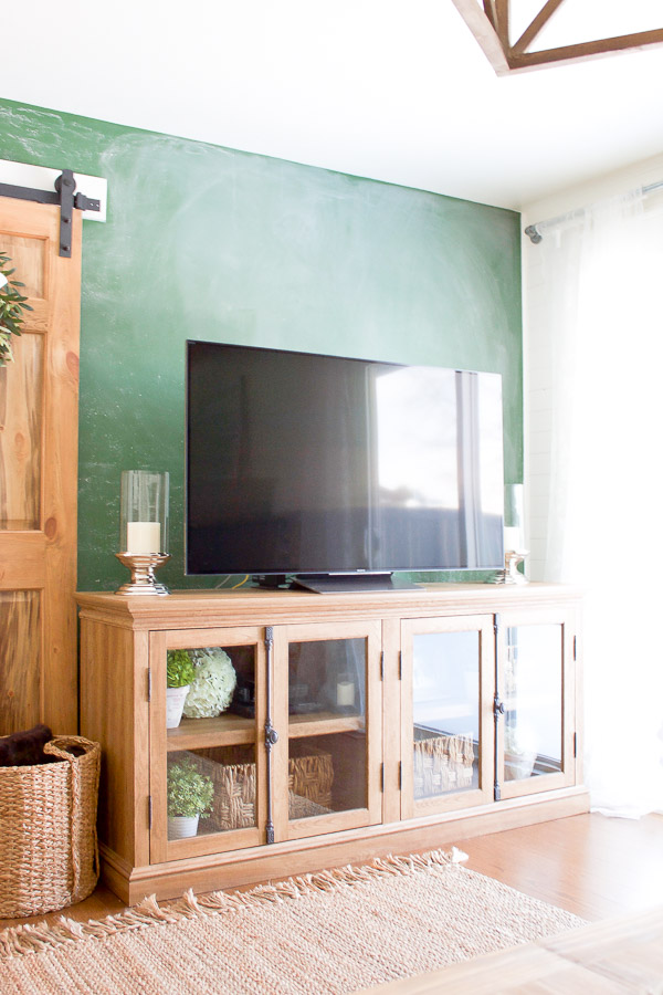 Simple tips to show you how to style a TV stand so you notice more than just the TV! | www.makingitinthemountains.com