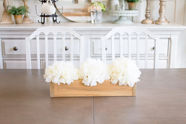 This farmhouse flower box was SO simple to create and makes for the perfect farmhouse decor all year round!