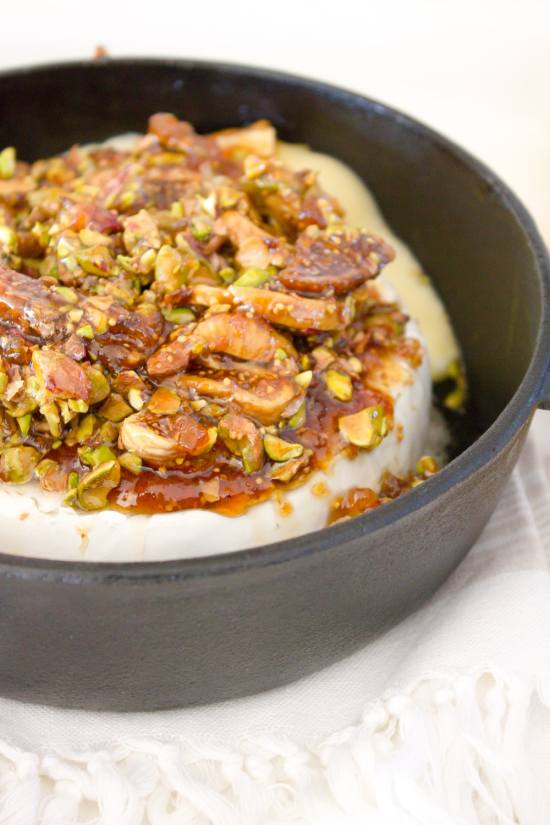 This fig + pistachio baked brie is amazingly delicious and SO easy to make!   www.makingitinthemountains.com