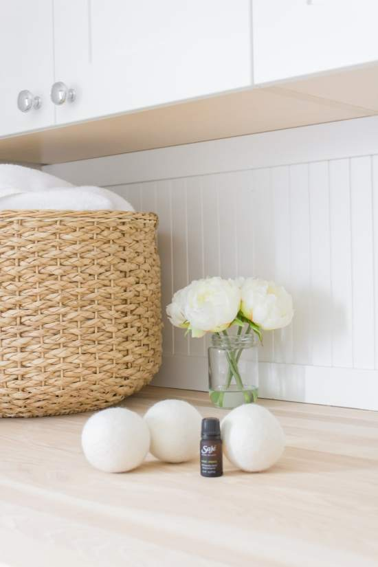 essential oils, wool dryer balls, flowers, laundry basket