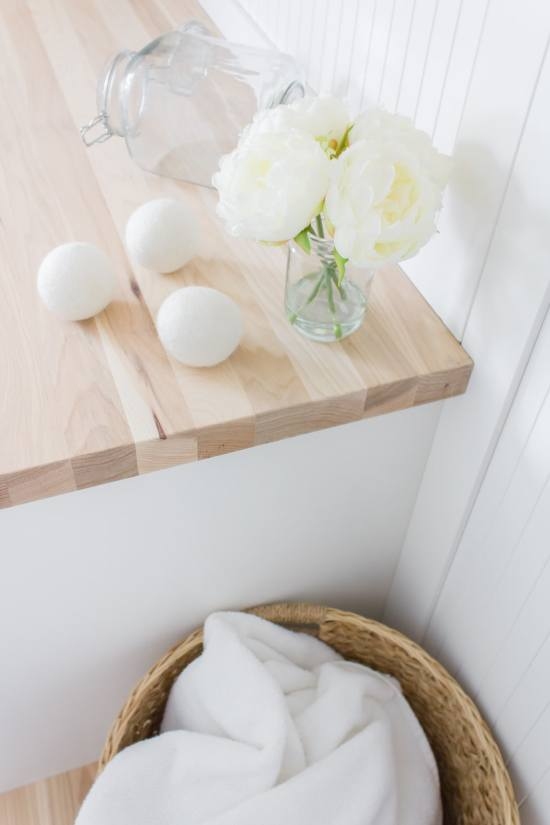 wool dryer balls and white laundry