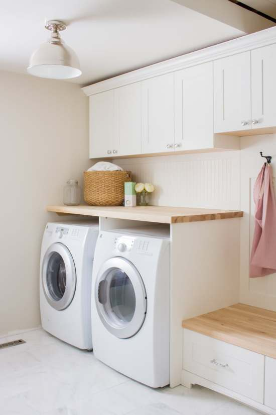 Farmhouse Style Laundry Room with White Cabinets