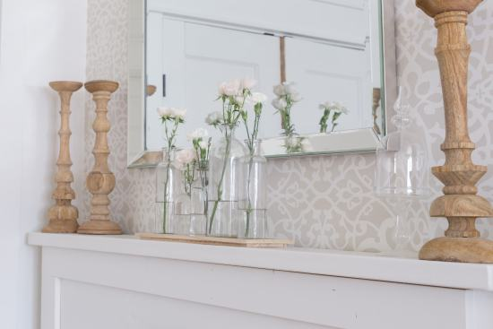 flowers, candlestick, fireplace mantel
