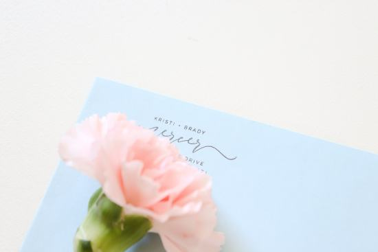 blue envelope, flower, address stamp