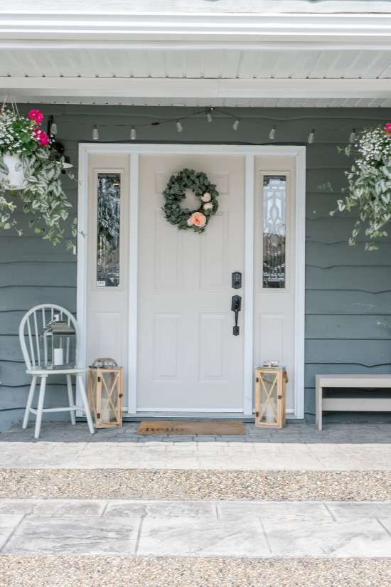 front door, summer wreath, lanterns, string lights