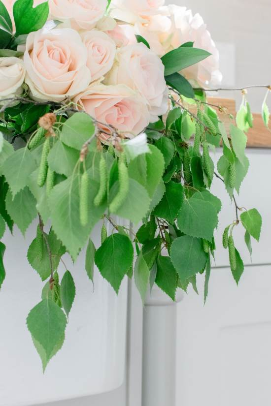 green leaves, pink roses, farmhouse sink