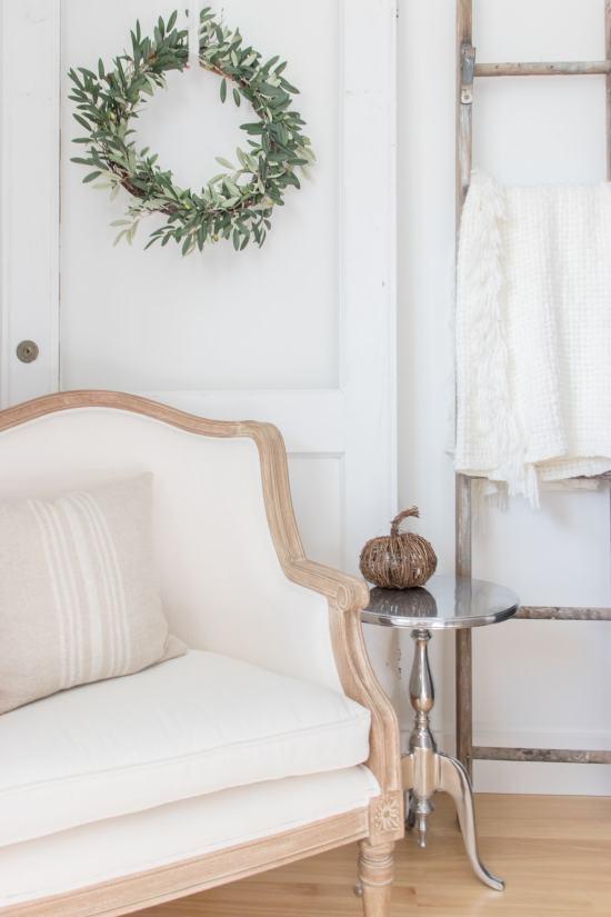 twine pumpkin, vintage chair, olive wreath, blanket ladder