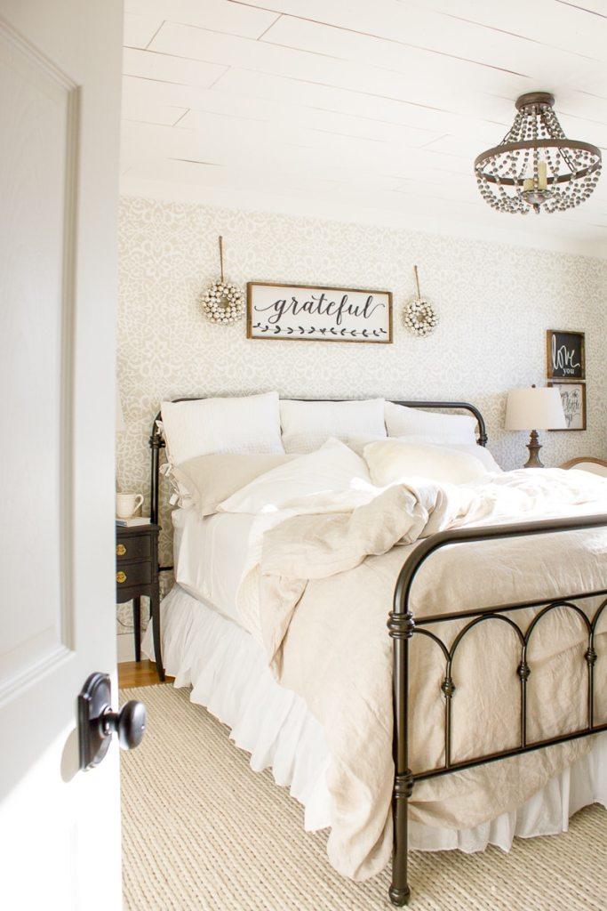 linen bedding, wall stencil, wood sign