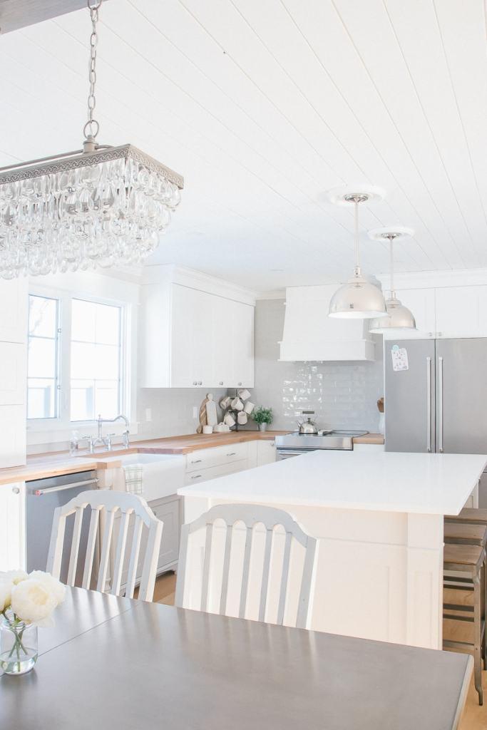 white kitchen cabinets, butcher block