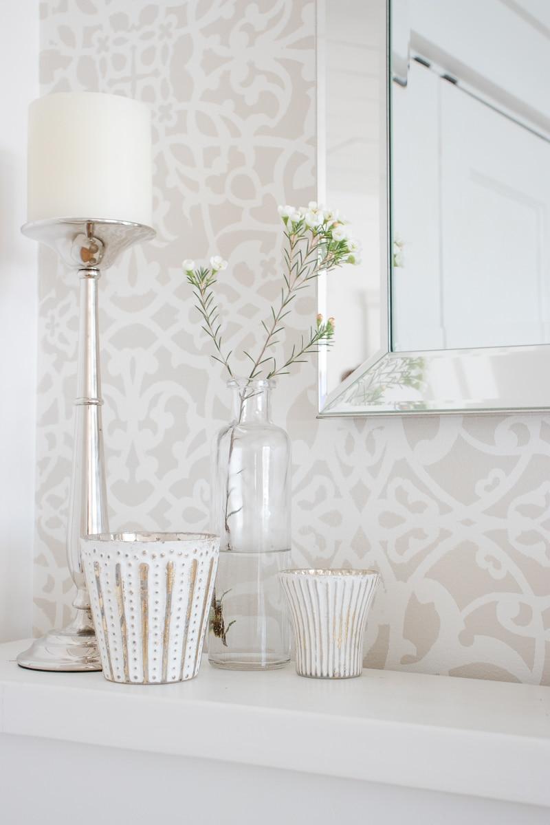 stencil wall, bottle vase, mercury glass candles