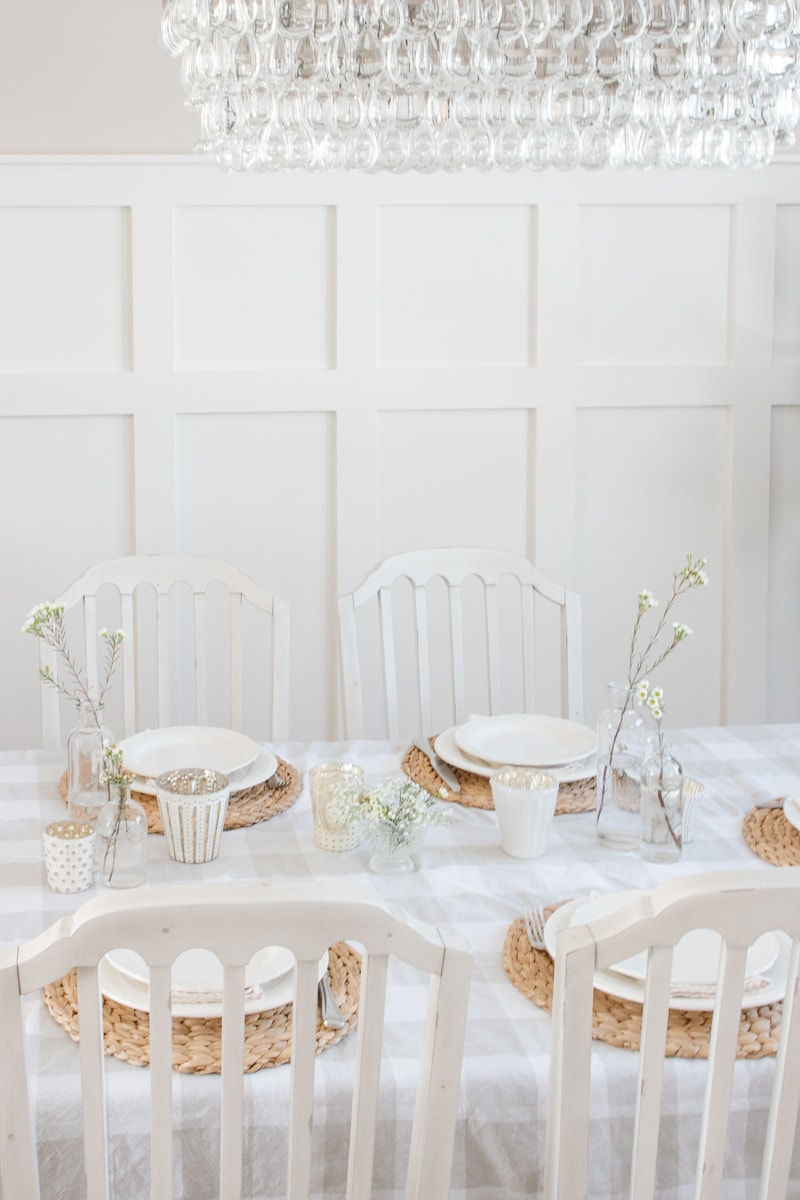 spring table, fresh flowers, white votives, buffalo check tablecloth