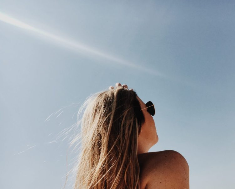 unsplash-female-outside-looking-up