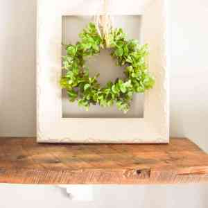 Simple Farmhouse Decor: Upcycled frame + wreath! Easy fixer upper and farmhouse style DIY that is budget friendly using an old frame. Add a fresh green wreath and it