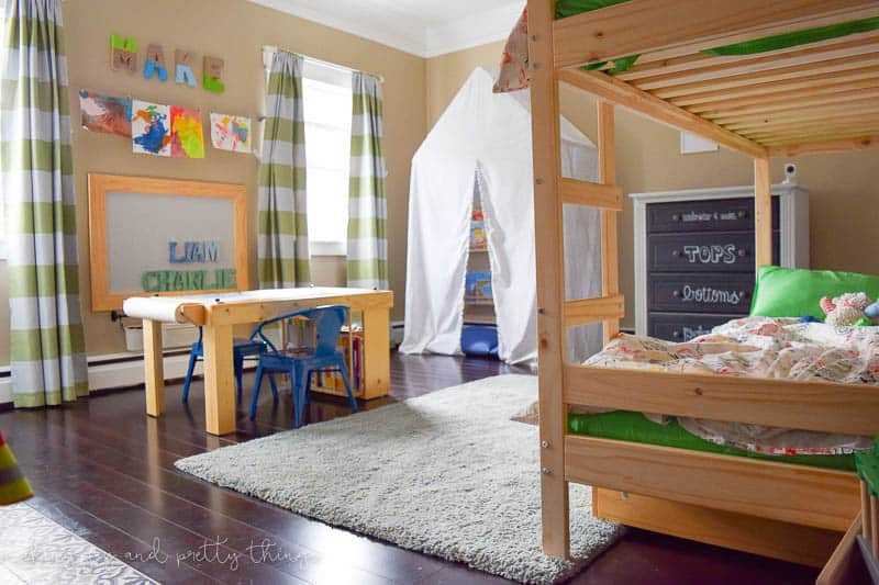 Shared Boys Bedroom packed with tons of storage and organization ideas, a kids craft table, kids reading nook, bunk beds, DIY magnet board, clothing storage and fun, bright and modern design!