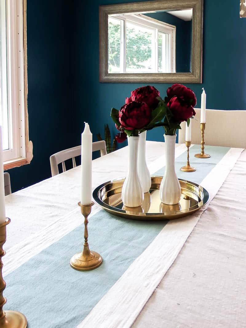 See how I used thrift store vases and just one type of flower to make the prettiest centerpiece perfect for Fall!
