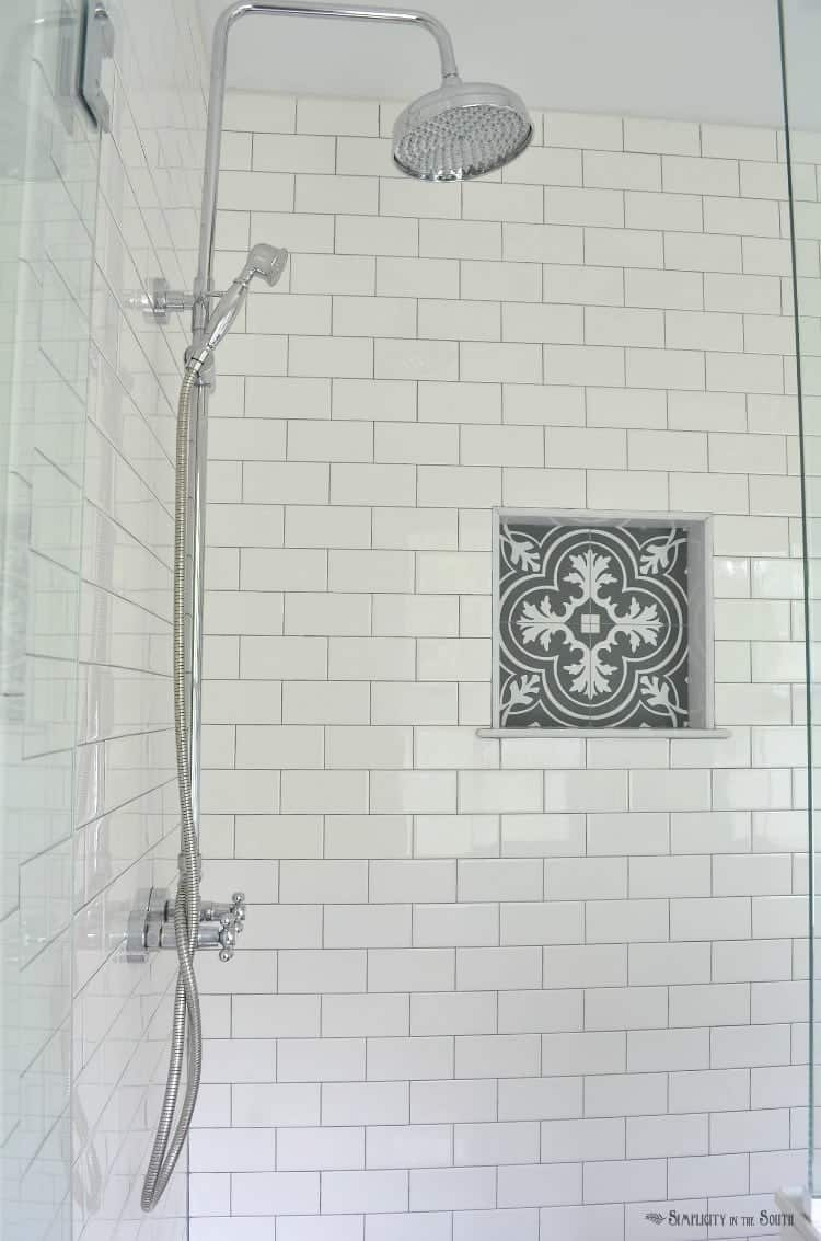 https www makingjoyandprettythings com 5 ways save bathroom renovation white subway tile is a classic i love the charcoal gray grout and the patterned tile that looks like cement tile in the shower cubby